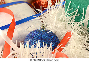 Christmas green gift with blue balls on white abstract background