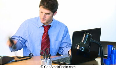 Handsome businessman working in office footage