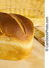 Artisan bread - Loaf of homemade artisan bread with knife on...