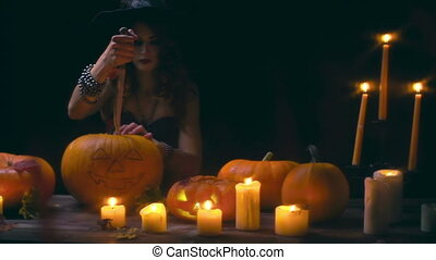 Carving Pumpkin Tradition - Close up of gorgeous witch...