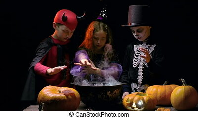 Enchanted Kids - Three children dressed for Halloween...