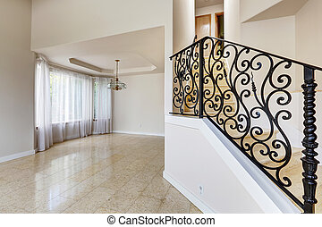 Emtpy house interior Marble staircase with black wrought...