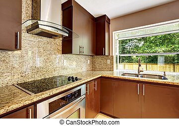 Modern kitchen room with matte brown cabinets and granite...
