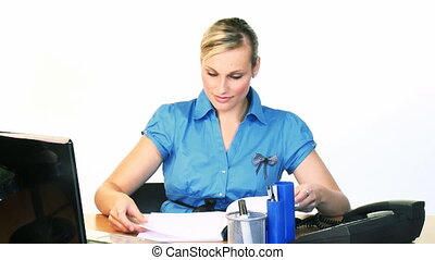 Businesswoman reading and writing footage - Attractive young...