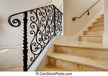 Marble staircase with black wrought iron railing - Emtpy...
