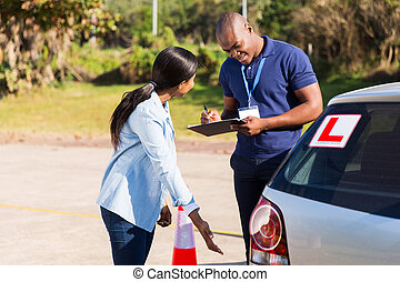 female african student driver pre test inspection - female...