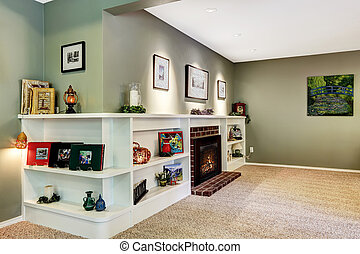 Living room corner with fireplace and decorated shelves