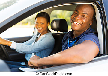 male african american driving instructor and student driver
