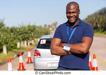 afro american driving instructor with arms crossed
