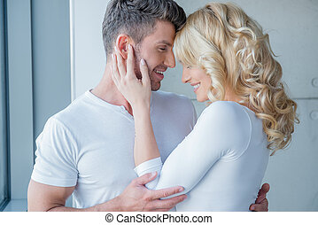 Loving couple enjoy a tender moment touching foreheads and...