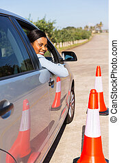 african student driver taking lessons - attractive african...