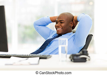 young african american businessman relaxed in office