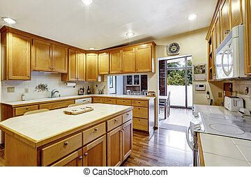 Kitchen room with wooden storage combination and kitchen...
