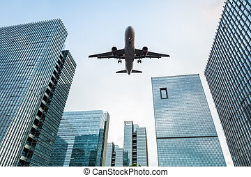 airplane and office buildings - upward view of the airplane...