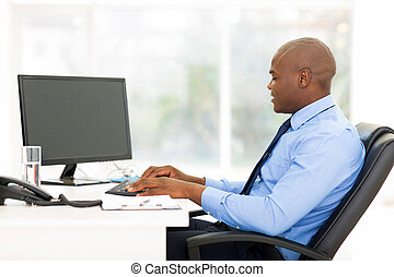 black business man typing on keyboard - black business man...