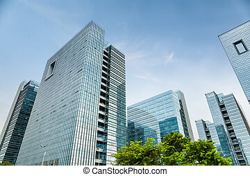 a group of modern office building - a group of glass office...