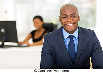 african american businessman with colleague on background