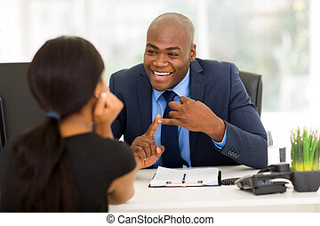 african american businessman meeting with client - friendly...