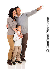 family pointing at empty copy space