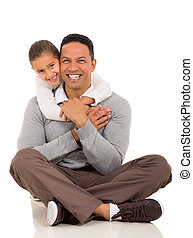 little girl hugging her father - portrait of happy little...