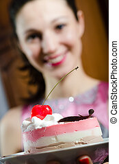 close up image of delicious slice of cake with cherry and...