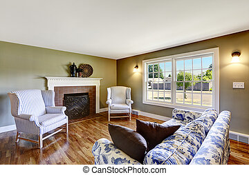 Living room with fireplace and antique chairs