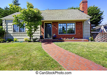 American house exterior with brick and clapboard siding trim...