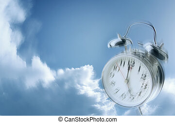 Time flies - Alarm clock in blue sky