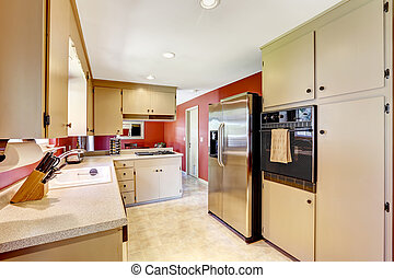 Kitchen room with bright red walls