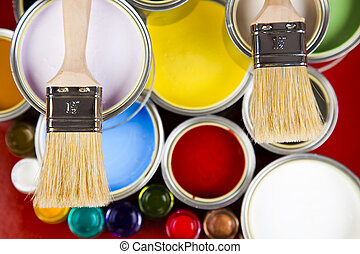 Paint cans - Cans and paint and brushes on the Colorful...