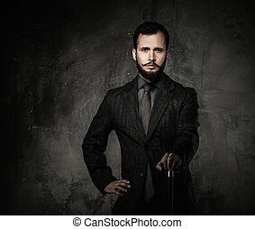 Handsome well-dressed man with stick