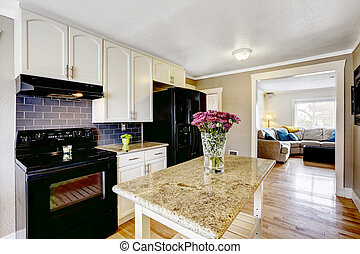 Kitchen island with granite top and flowers