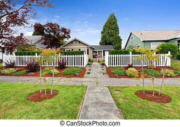 American house exterior with beautiful front yard landscape desi