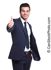 business man showing thumb up - young business man showing...