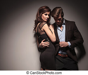 elegant woman embracing her boyfriend - Side view of a...