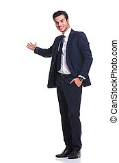 happy business man welcoming you - Side view of a happy...