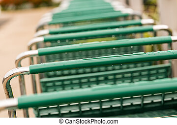 Shopping cart - Large green shopping cart in a row