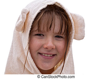 Smiling little girl in a bathrobe isolated on white...