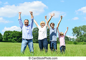 Happy family together raising their arms