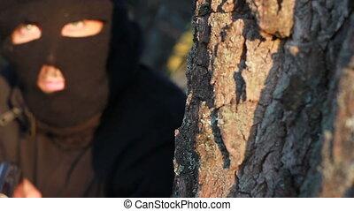 masked terrorist with a  gun