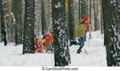 Sledge Race - Five joyous friends running and riding...