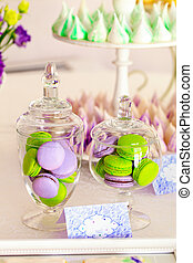 Sweet holiday buffet with macarons and meringues