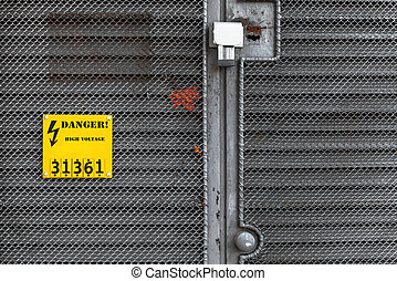 Grey fence with yellow warning sign - Grey fence with yellow...