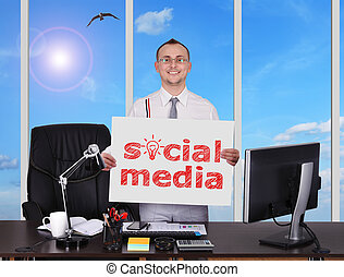 social media - young businessman holding poster with social...