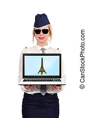 laptop with eiffel tower - stewardess holding laptop with...