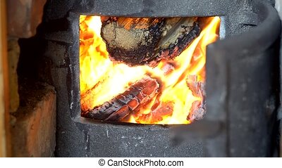 blazing fire in wood burning stove - firewood wood burn...