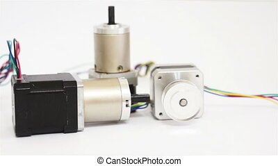 Industrial Three Stepper Motors Dol - A dolly shot of three...