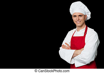 Chef standing with arms crossed - Confident male chef...