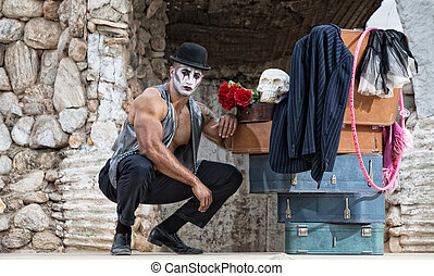 Handsome Cirque Performer Kneeling - Handsome muscular...