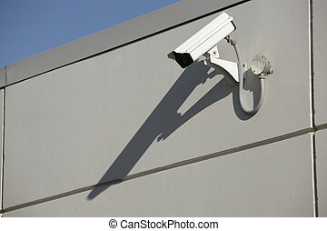 security camera - security video camera mounted outdoors on...